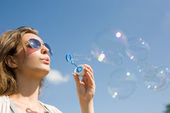 Blowing bubbles into the sky. Royalty Free Stock Image