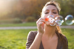 Blowing bubbles into the wind. Royalty Free Stock Photography