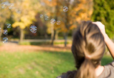 Blowing bubbles into the wind. Stock Image