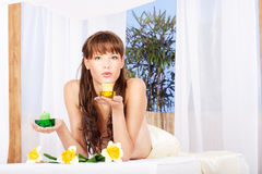 Blowing candle at massage table in spa resort Stock Image