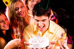 Blowing on candles Royalty Free Stock Photography