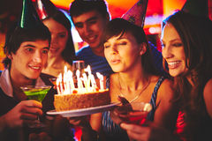 Blowing on candles in the dark Stock Photography