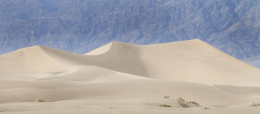 Blowing desert sand dunes. A view of a large sand dune and blowing sand in Death Valley, California stock photos