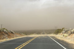 Blowing and Drifting Sand on Road Royalty Free Stock Photography