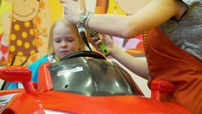 Blowing dry hair of little girl. In hair salon stock video