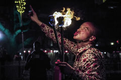 Man blowing fire. Expressive man face blowing fire at The Hague Carnival festival Royalty Free Stock Image