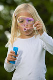 Blowing a giant soapbubble Royalty Free Stock Photography