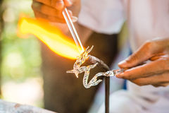 Blowing glass in a dragon shape Stock Photography