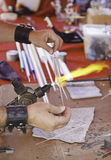 Blowing glass, manual labor. Operator working with fire glass, artisan Stock Images