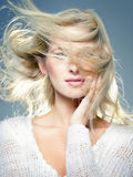 Blowing hair. Close up portrait of young blonde, with blowing hair Royalty Free Stock Photos