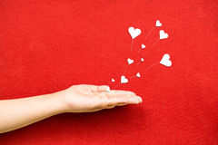 Blowing Hearts from a Hand Royalty Free Stock Photography