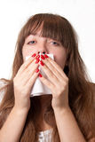 Blowing her nose. Girl blowing her nose-over white Royalty Free Stock Images