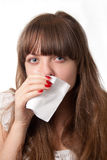 Blowing her nose. Girl blowing her nose-over white Stock Photos