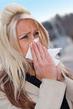 Blowing Her Nose Royalty Free Stock Images