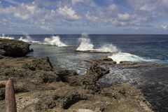 Blowing holes in the Kingdom of Tonga. Natural blowholes Mapu a Vaea on Tongatapu in the Kingdom of Tonga stock photo