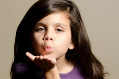 Blowing a kiss. A little girl showing that she's a blowing a kiss Royalty Free Stock Images