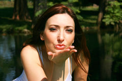Blowing kiss. A young woman blowing a kiss in the camera's direction Stock Photography