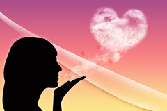 Blowing a kiss. Purple background with woman silhouette Stock Photos