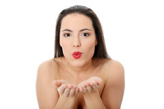 Blowing a kiss from beautiful young woman Royalty Free Stock Images