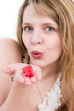 Blowing kisses. A pretty blond girl blowing kisses Royalty Free Stock Photos