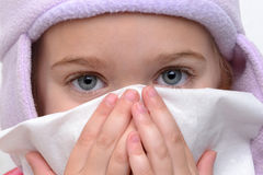 Blowing Nose. Little girl blowing nose with tissue Royalty Free Stock Photo