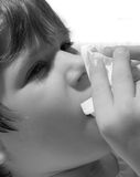 Blowing Nose. Boy with the flu virus or cold blowing his runny nose. Done in black and white Royalty Free Stock Images
