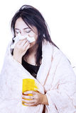 Blowing nose with tissue isolated over white Royalty Free Stock Image