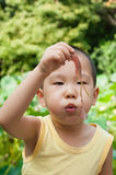 Boy blowing leaf  Royalty Free Stock Image