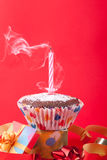 Blowing out birthday candle Stock Photos