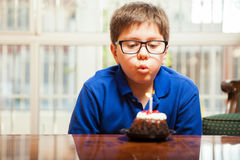 Blowing out a candle Stock Images