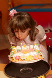 Blowing out candles Stock Image