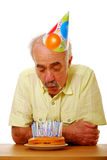 Blowing out candles Stock Photo