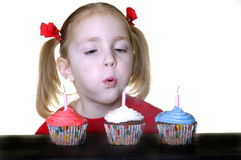 Blowing out Candles Stock Photography