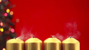 Blowing out four christmas candles after advent Royalty Free Stock Photography