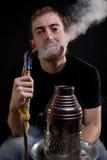Blowing out smoke Stock Image