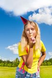 Blowing in party horn Royalty Free Stock Photo