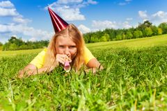 Blowing in party noisemaker whistle Stock Photography