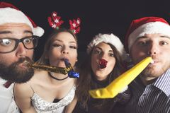 Blowing party whistles Royalty Free Stock Photography