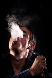 Blowing smoke Royalty Free Stock Images