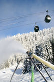 Blowing Snow. A snowgun on Whistler mountain makes snow when mother nature doesn't Royalty Free Stock Image