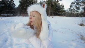 Blowing snow from gloves. stock footage