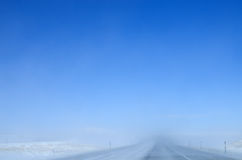 Blowing snow on highway Royalty Free Stock Photos