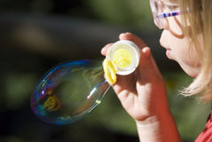 Blowing soap bubbles Stock Photos