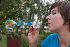 Blowing soap bubbles royalty free stock images
