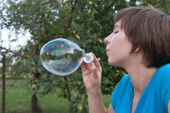Blowing soap bubbles Stock Images