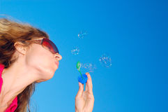 Blowing soap bubbles Royalty Free Stock Photos