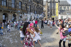 Blowing soap bubbles in Amsterdam Stock Images