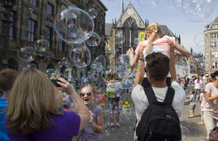 Blowing soap bubbles in Amsterdam Royalty Free Stock Image