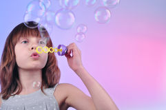 Blowing soap bubbles. Cute child blowing soap bubbles Royalty Free Stock Photos