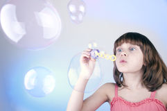 Blowing soap bubbles. Little girl  blowing soap bubbles Royalty Free Stock Photography